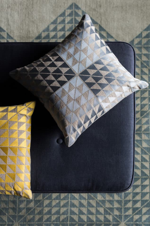 Yellow and grey geometric cushions by Niki Jones