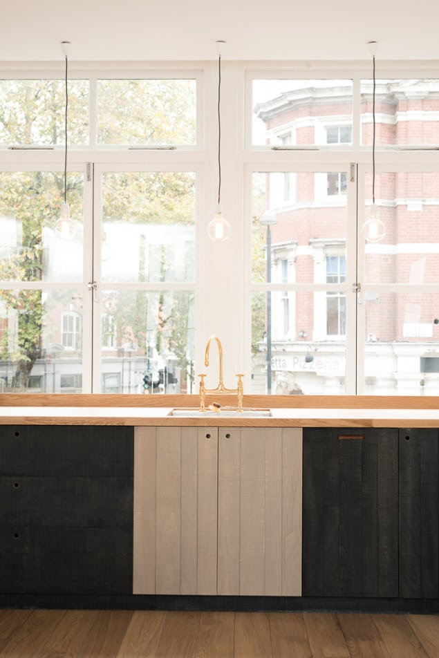 """The Clerkenwell Apartment features the Sebastian Cox Kitchen range by deVOL. The industrial style open space contains the understated, handmade kitchen that deVOL founder Paul O'Leary describes as """"Urban Rustic; it brings a little bit of woodland into the city, with some style."""""""