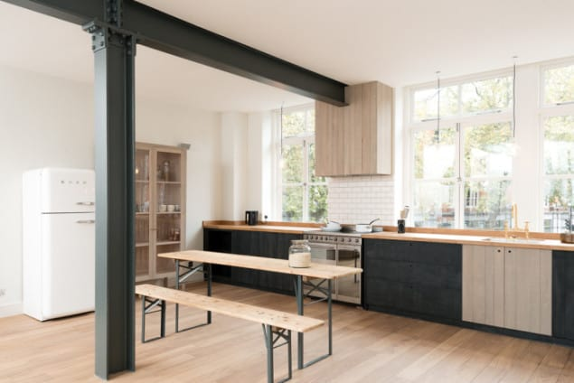 "The Clerkenwell Apartment features the Sebastian Cox Kitchen range by deVOL. The industrial style open space contains the understated, handmade kitchen that deVOL founder Paul O'Leary describes as ""Urban Rustic; it brings a little bit of woodland into the city, with some style."""
