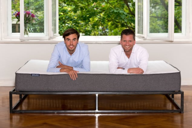 Felix Baer and Andreas Bauer, The Founders of Bruno Mattress lying on one of their mattresses