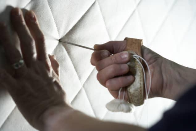 Naturalmat needle going into organic mattress