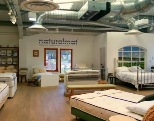 The Naturalmat Showroom in Topsham in Devon showcasing a selection of organic mattresses and bedding and a variety of beds