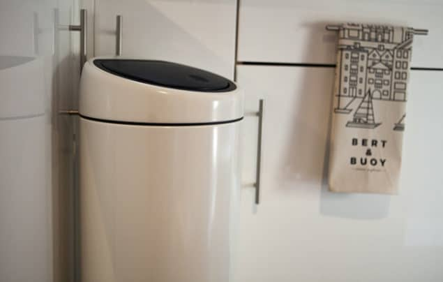 brabantia white touch bin situated in a modern monochrome kitchen