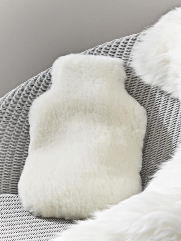 Create a cosy winter home with this Sheepskin Hot Water Bottle Cover from Cox & Cox