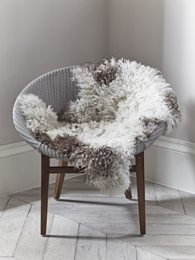Create a cosy winter home with a Curly Sheepskin from Cox & Cox