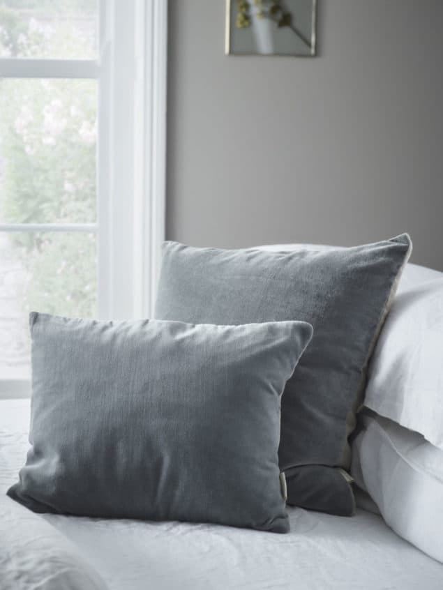 Create a cosy winter home with these grey velvet and linen cushions from Cox & Cox