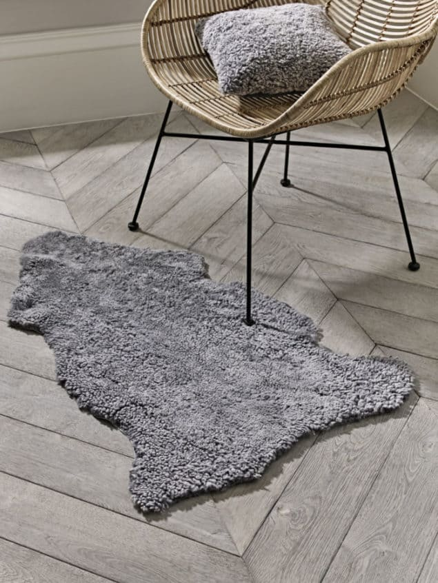 Create a cosy winter home with this grey curly sheepskin rug from Cox & Cox