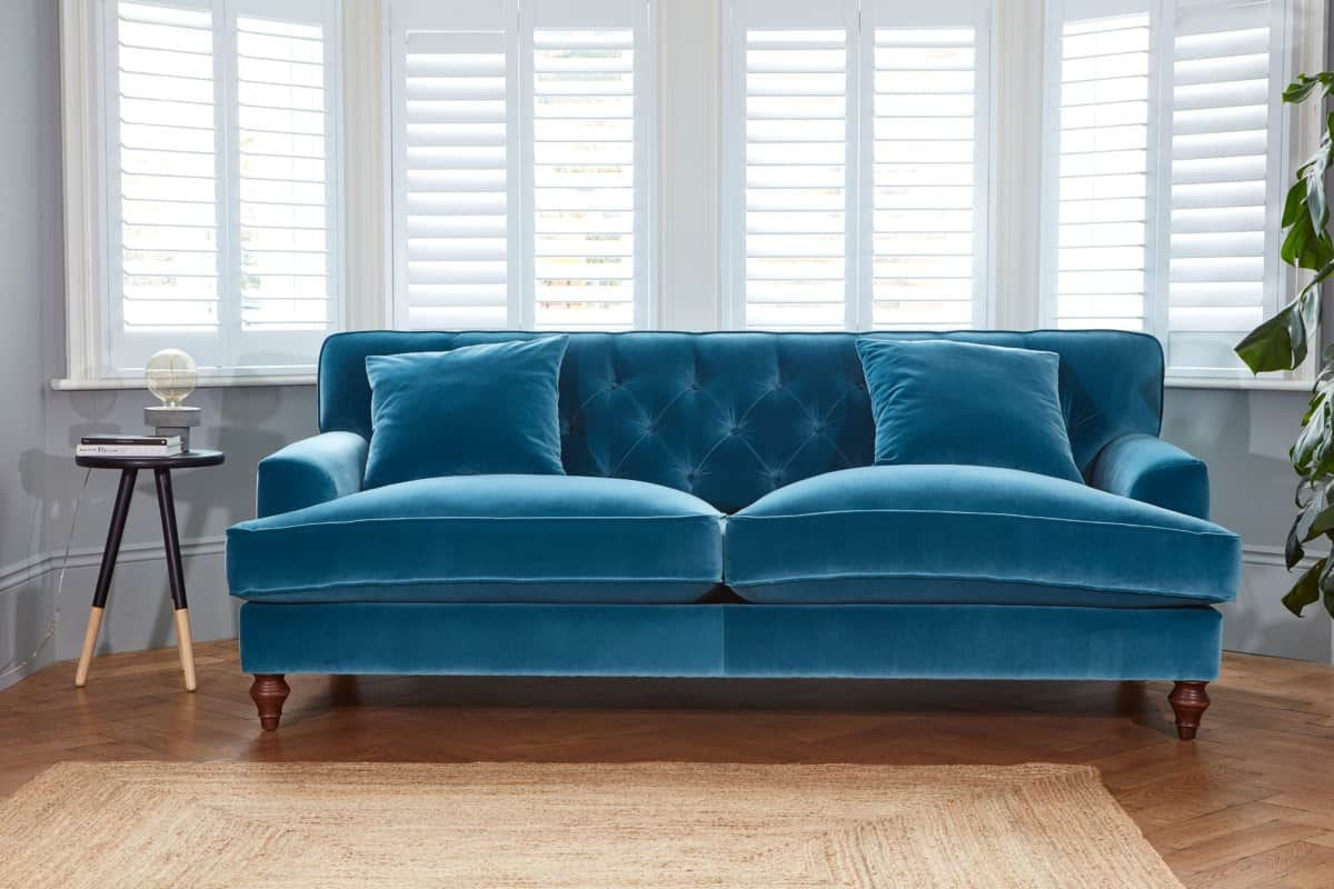 Traditional button back blue velvet sofas from Darlings of Chelsea