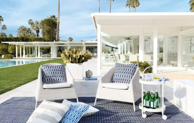 Outdoor living space featuring seating, rug, cushions and a bar cart