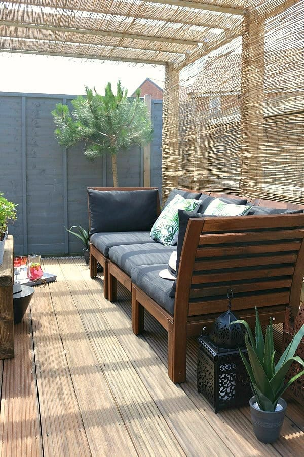 Dear Designers garen makeover featuring pergola, reed screening, outdoor sofa