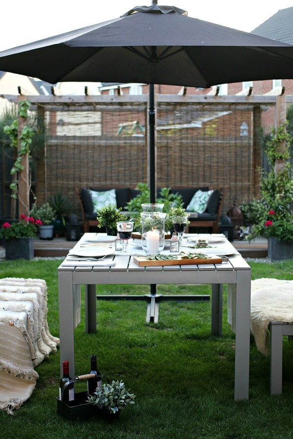 Dear Designers garden style featuring dining table, throws, sheepskins and candles