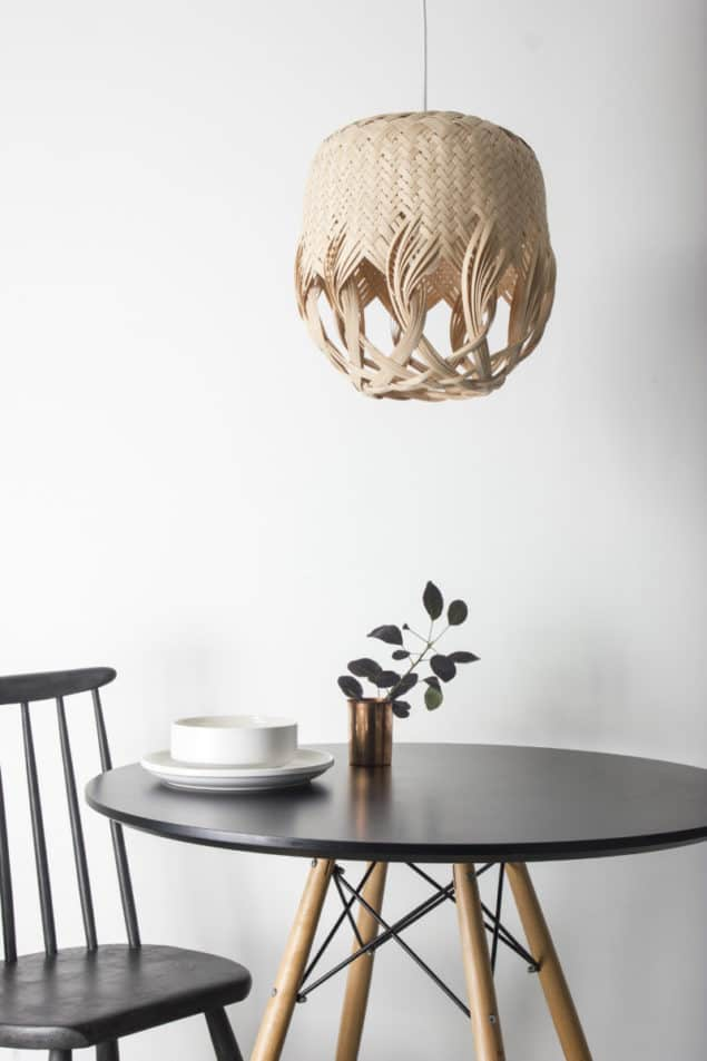 PREN lighting by Louise Tucker hanging above a small round dining table