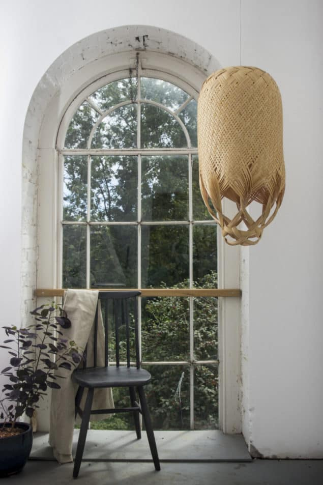 Pren Lighting by Louise Tucker suspended in front of a window