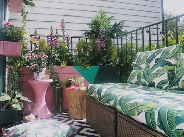 Melanie Lissack Interiors Garden Balcony Makeover featuring botanical upholstery, painted planers and outdoor stools