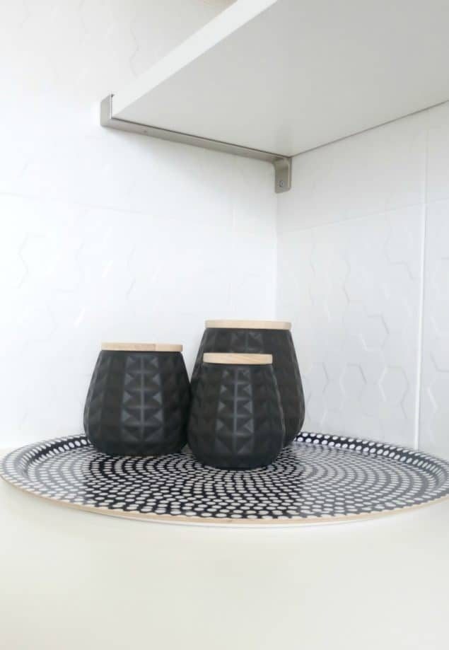The Design Sheppard Kitchen Makeover featuring geometric patterned black storage jars from Mia Fleur