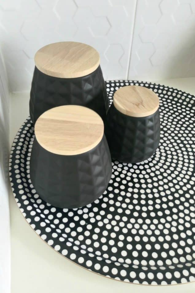The Design Sheppard Kitchen Makeover featuring geometric patterned black storage jars from Mia Fleur and geometric tray from Marimekko