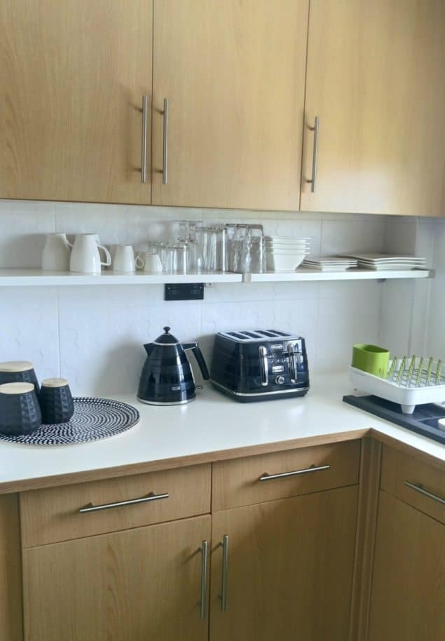 The Design Sheppard Kitchen Makeover featuring black kitchen accessories and open