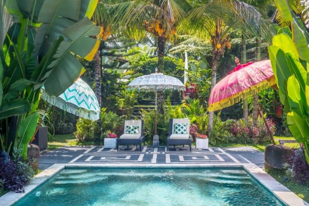 3 East London Flamboyant Parasols By Pool