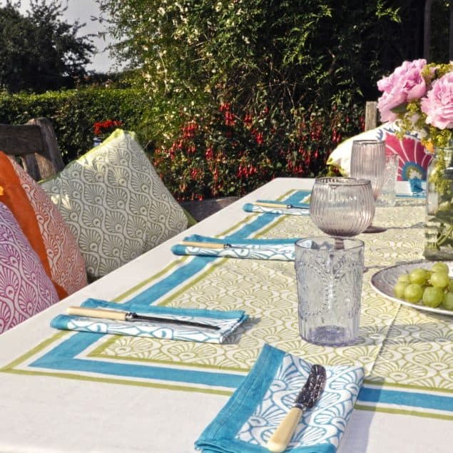 Lime green tablecloth with turquoise napkins East London Parasols