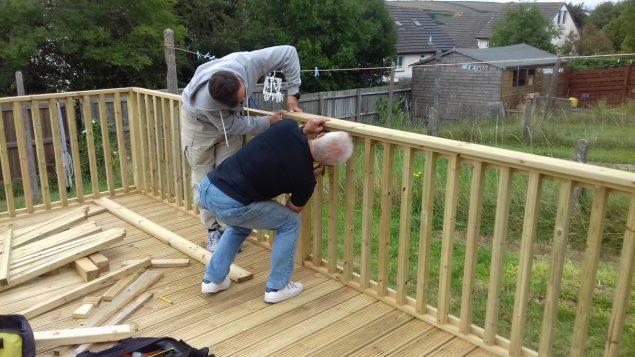 Garden Makeover installing the decking balustrade handrail