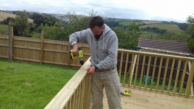 Garden Makeover installing the handrail of the decking baulstrade by Richard Burbidge