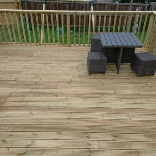 Garden Decking Makeover featuring a raised deck with balustrade