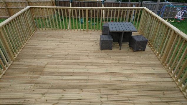 Garden Makeover featuring a raised decking with balustrade