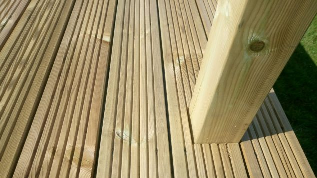 Garden Makeover newels fitted in raised decking