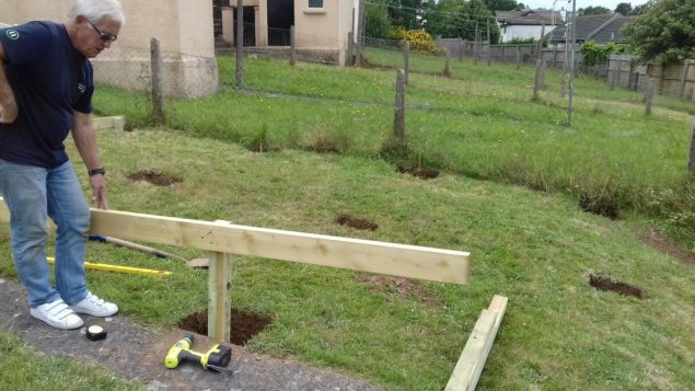 Garden makeover building the raised decking frame