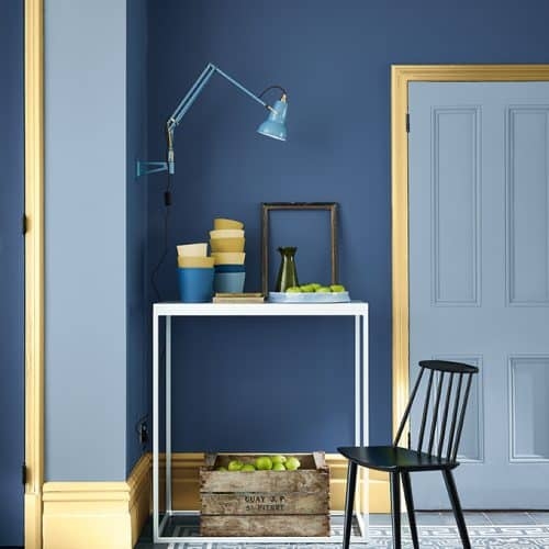 Little Greene Paint - Blue room with yellow coloured skirting board