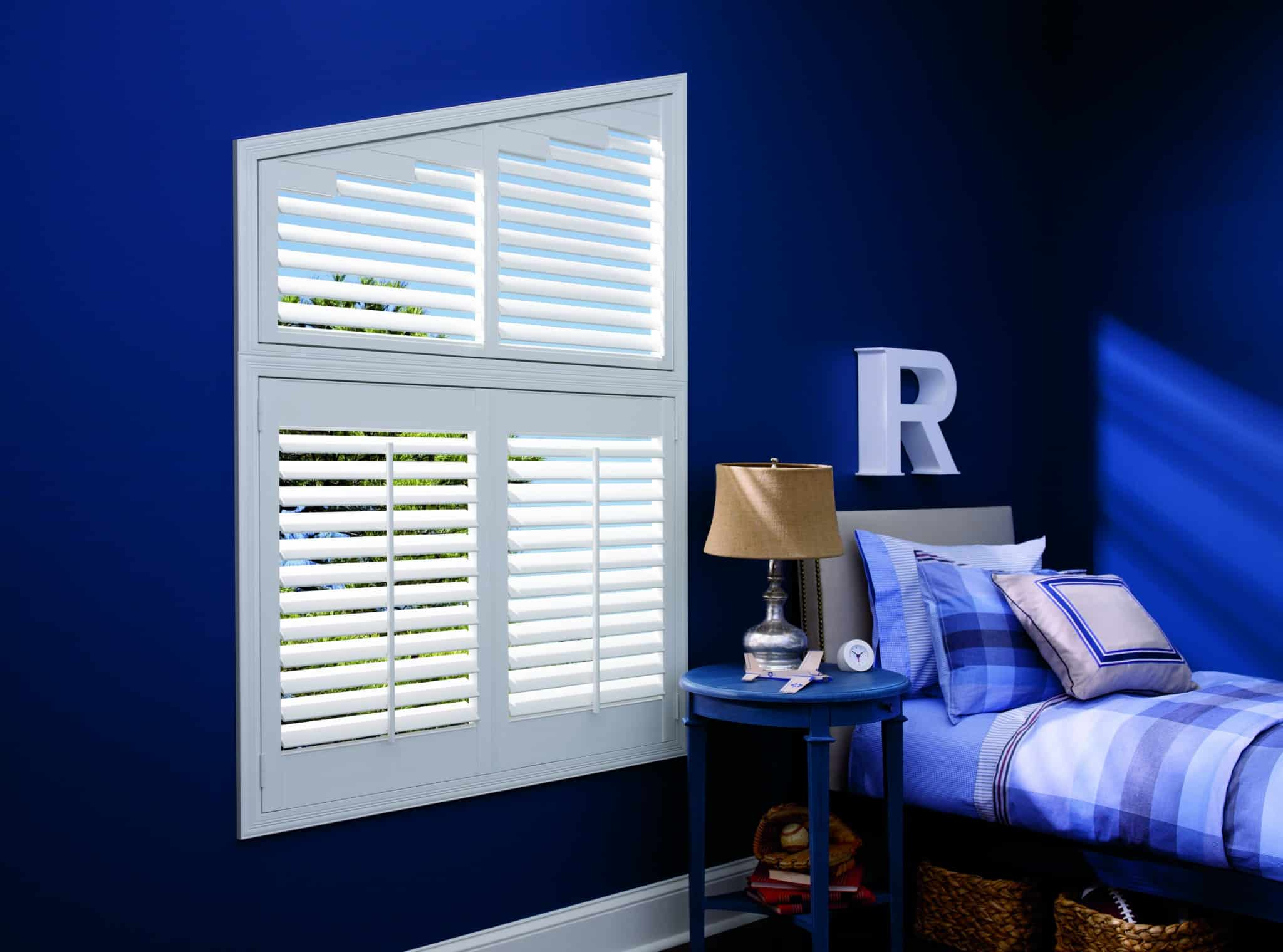 Luxaflex Faux Wood Shutter_Angled_bedroom_blue walls