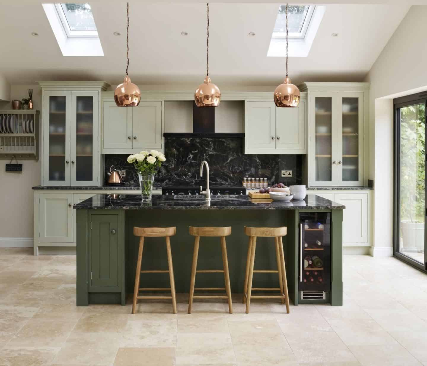 This Canterbury inspired kitchen by Davonport is hand-painted using Mizzle and Green Smoke, both Farrow & Ball, to introduce an organic, natural feel to the space.