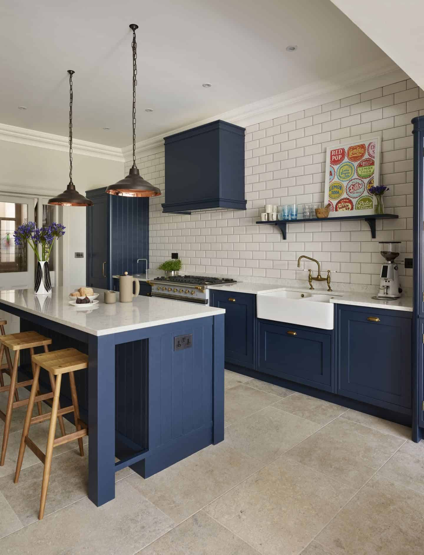 This Holkham inspired kitchen by Davonport is hand-painted using Bond Street by Mylands, set against the crisp backdrop of white worktops and metro tiles
