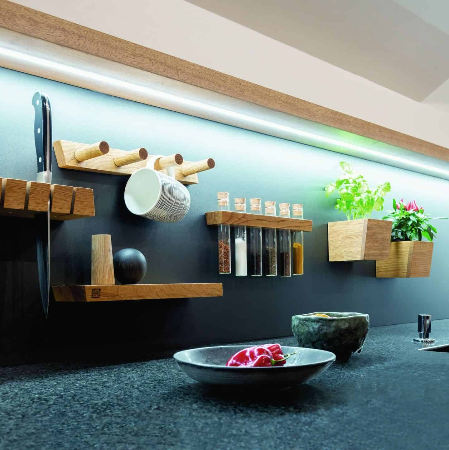 Steelline magnet is a Magnetic Storage System by 3s design. Wooden storage units attached by magnets to a kitchen splash back. Photo By Doris Kodric