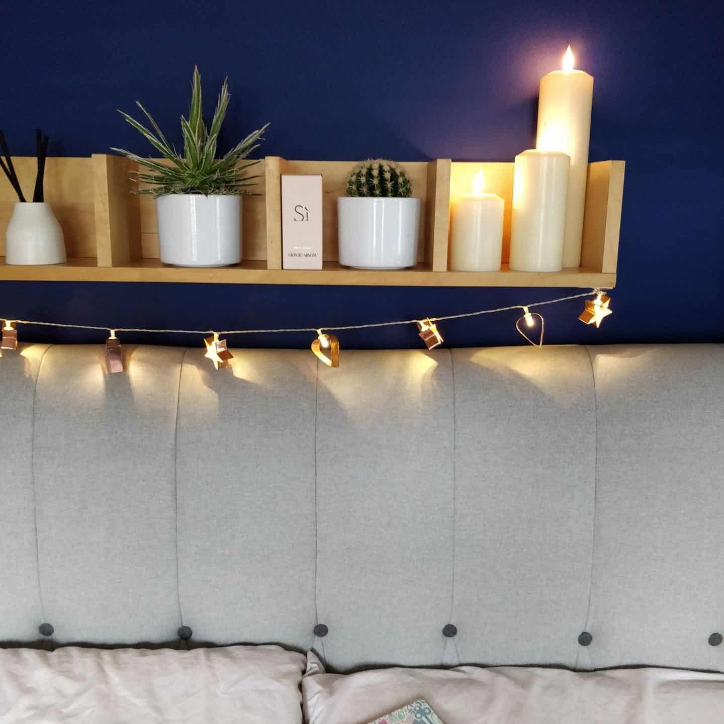 Realistic LED candles from Candled on a bedroom shelf
