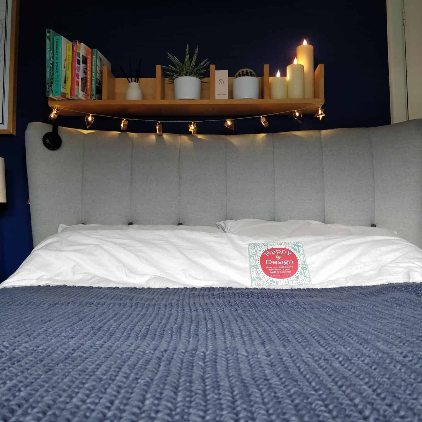 Realistic LED candles from Candled on a bedroom shelf 3