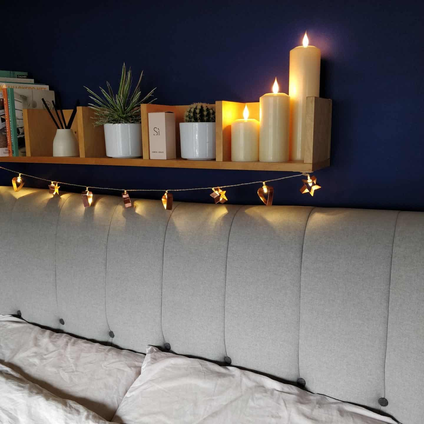Realistic LED candles from Candled on a bedroom shelf 4
