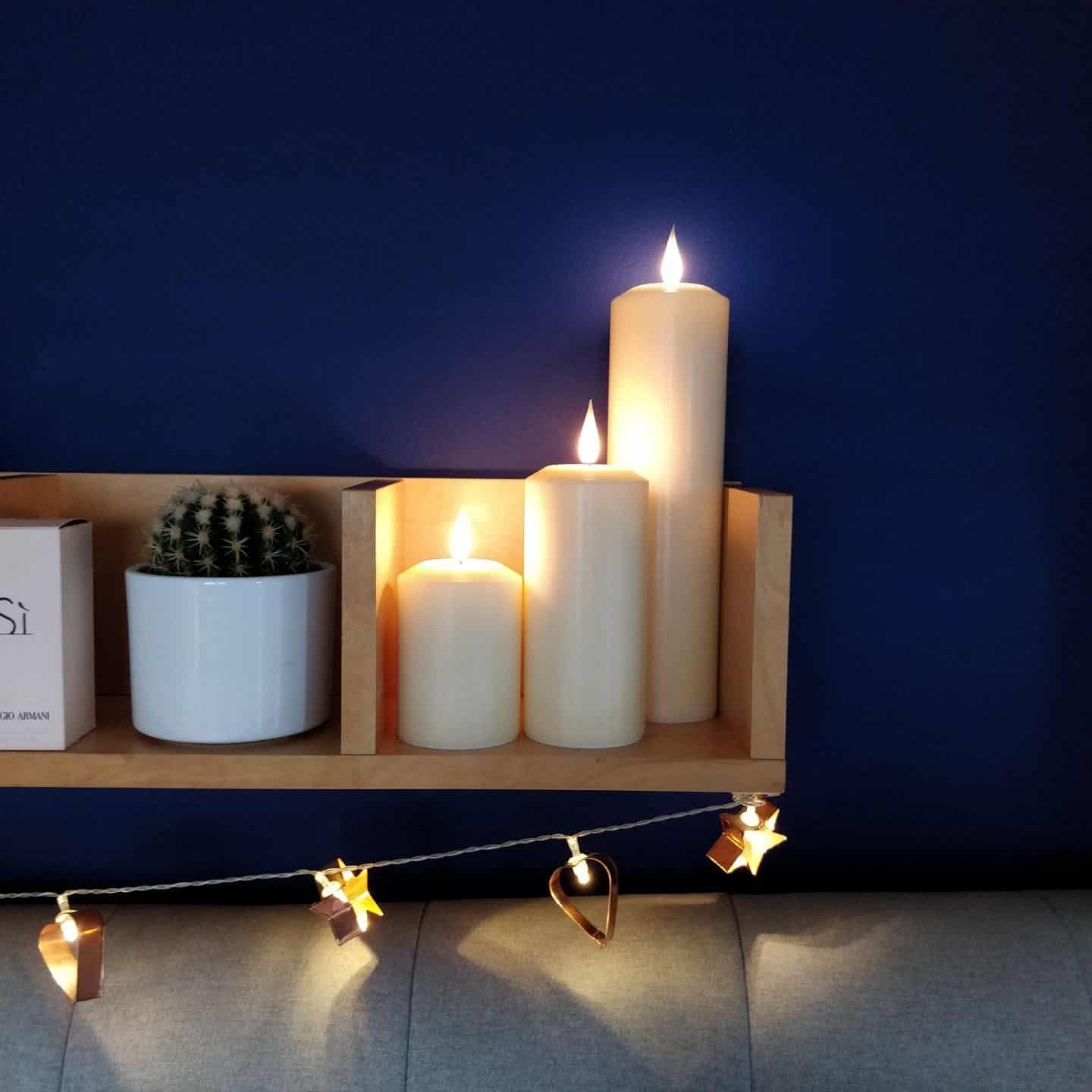 Realistic LED candles from Candled on a bedroom shelf 5