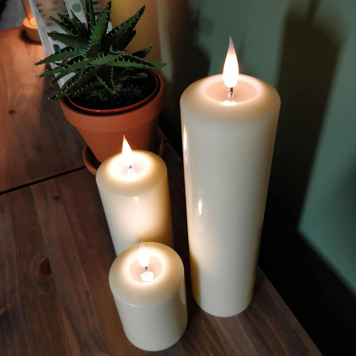 Realistic LED candles from Candled on a sideboard 8