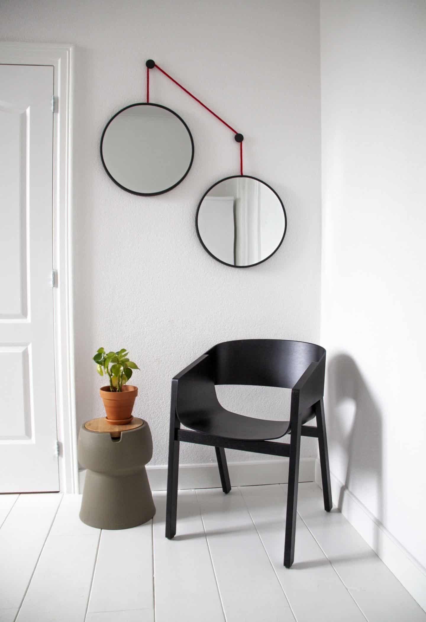 Dutch design brand Jokjor Twins hanging cantilevered round mirror set