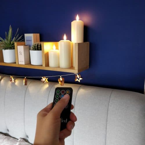 Remote Control Faux pillar LED candles from Candled on a bedroom shelf 5