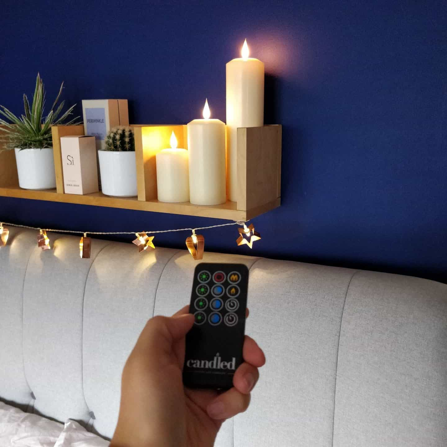 Remote Control realistic LED candles from Candled on a bedroom shelf 6