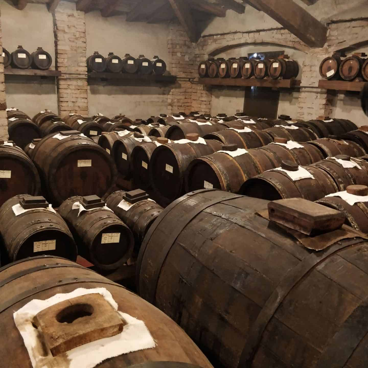 Casks of balsamic vinegar maturing in the loft space of a balsamic vinegar factory in Italy
