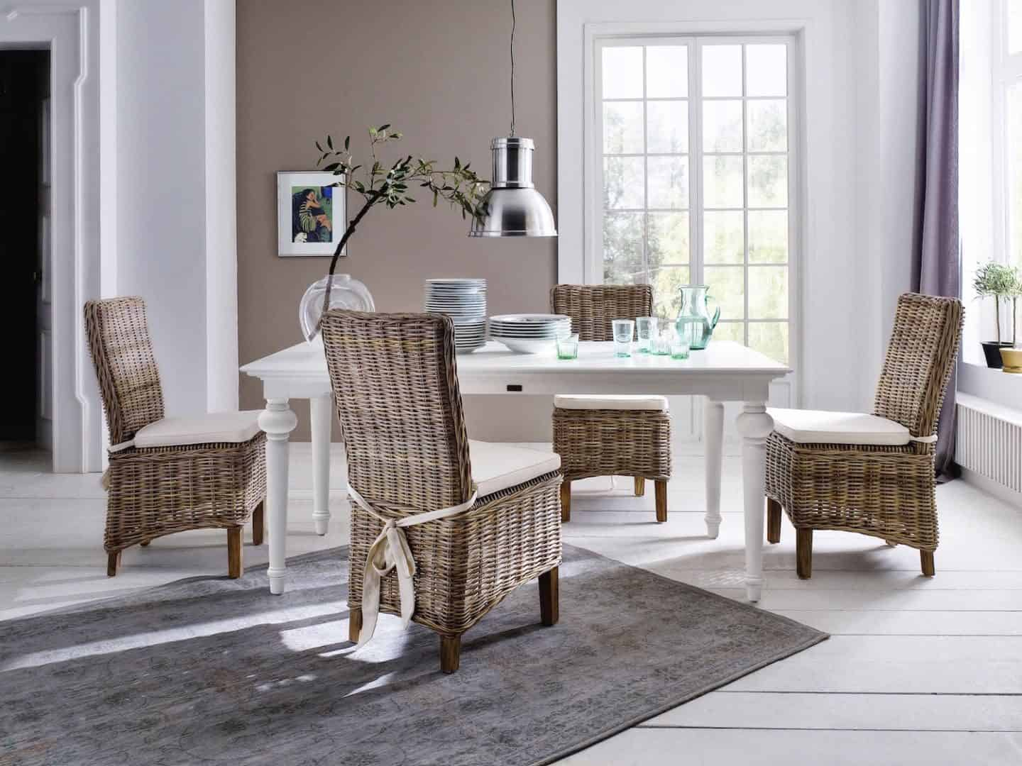 New Nordic interior featuring white floor boards, rattan furniture  and neutral walls. Furniture from the Provence range from Novasolo