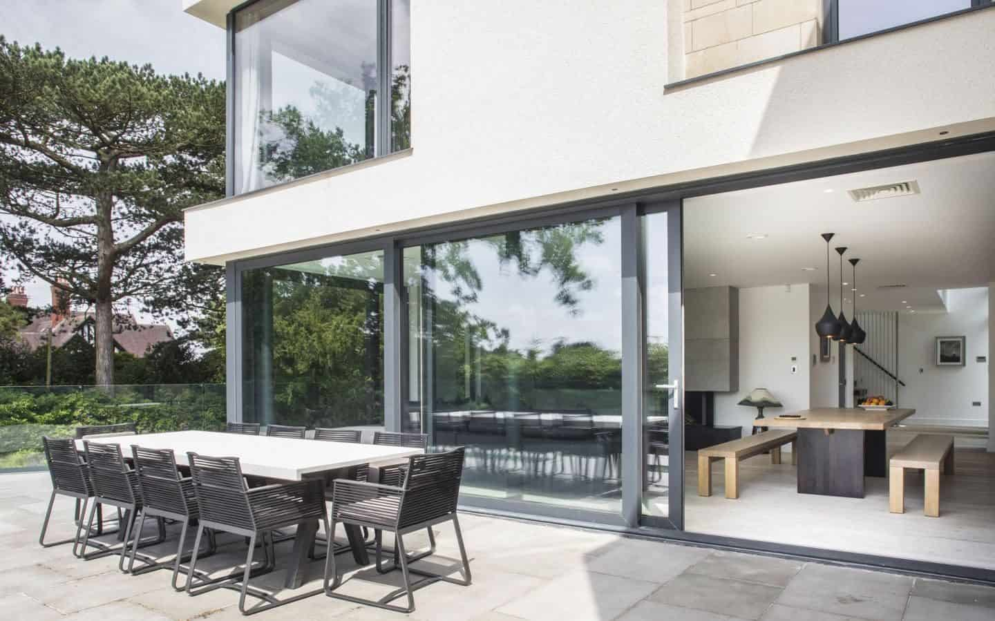 Pilkington Glass - Large glazed sliding doors from dining room out to garden