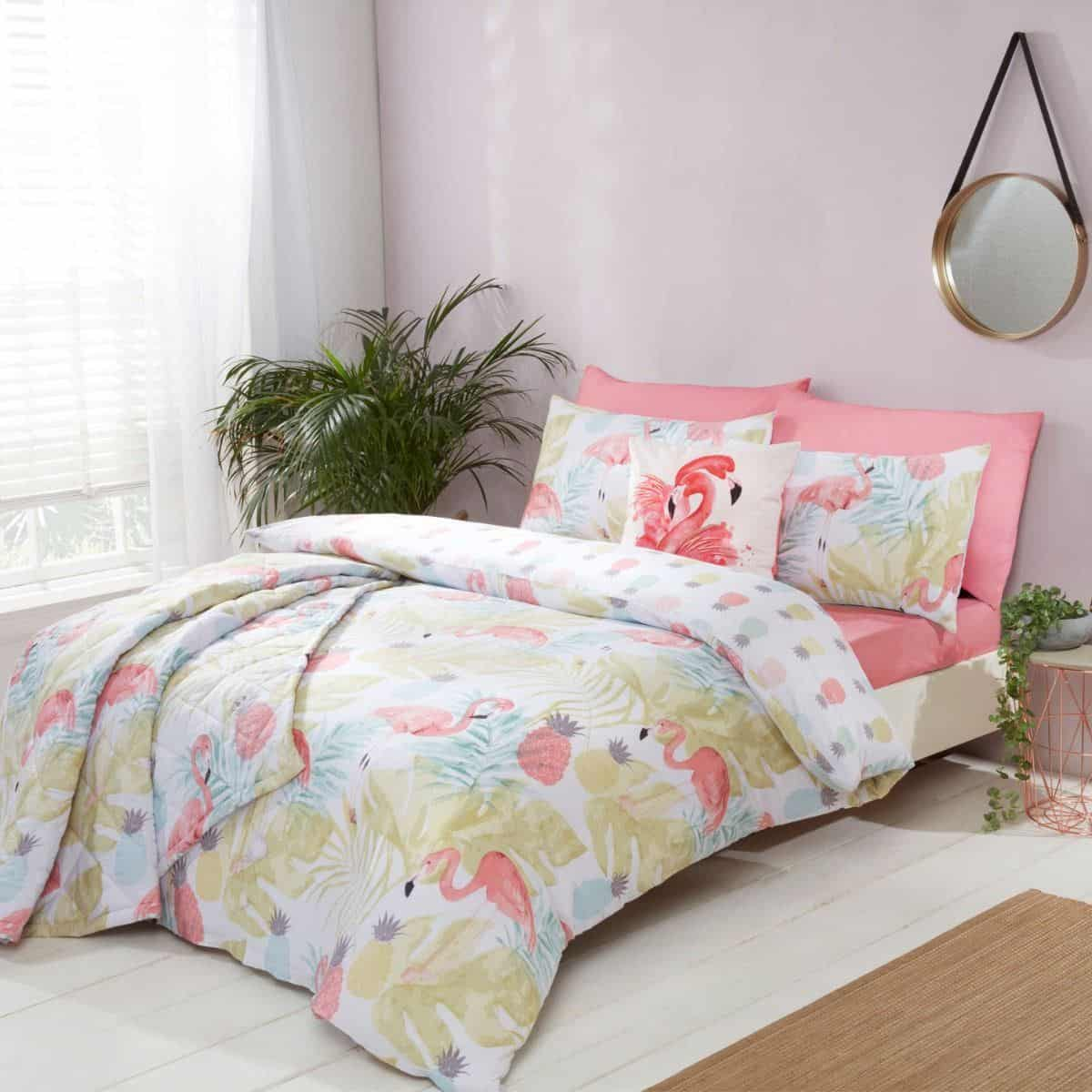 A feminine bedroom in grey and pink tomes featuring tropical flamingo bedding. The relaxing tones of this bedroom will aid good quality sleep.