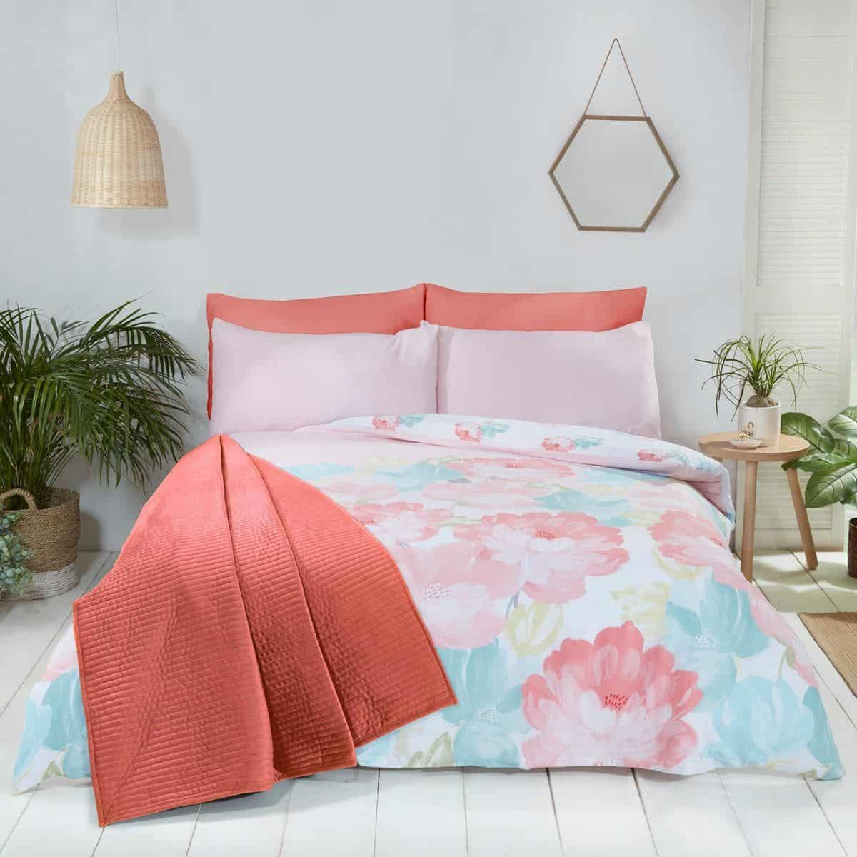 A coral and blue floral bedroom in soft tones will help to promote good quality sleep