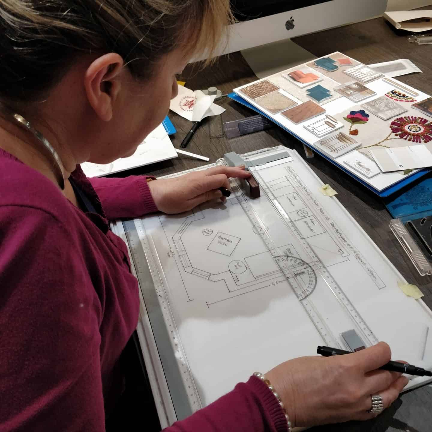 Drawing up scale floor plans at Juliette's interior design school in London