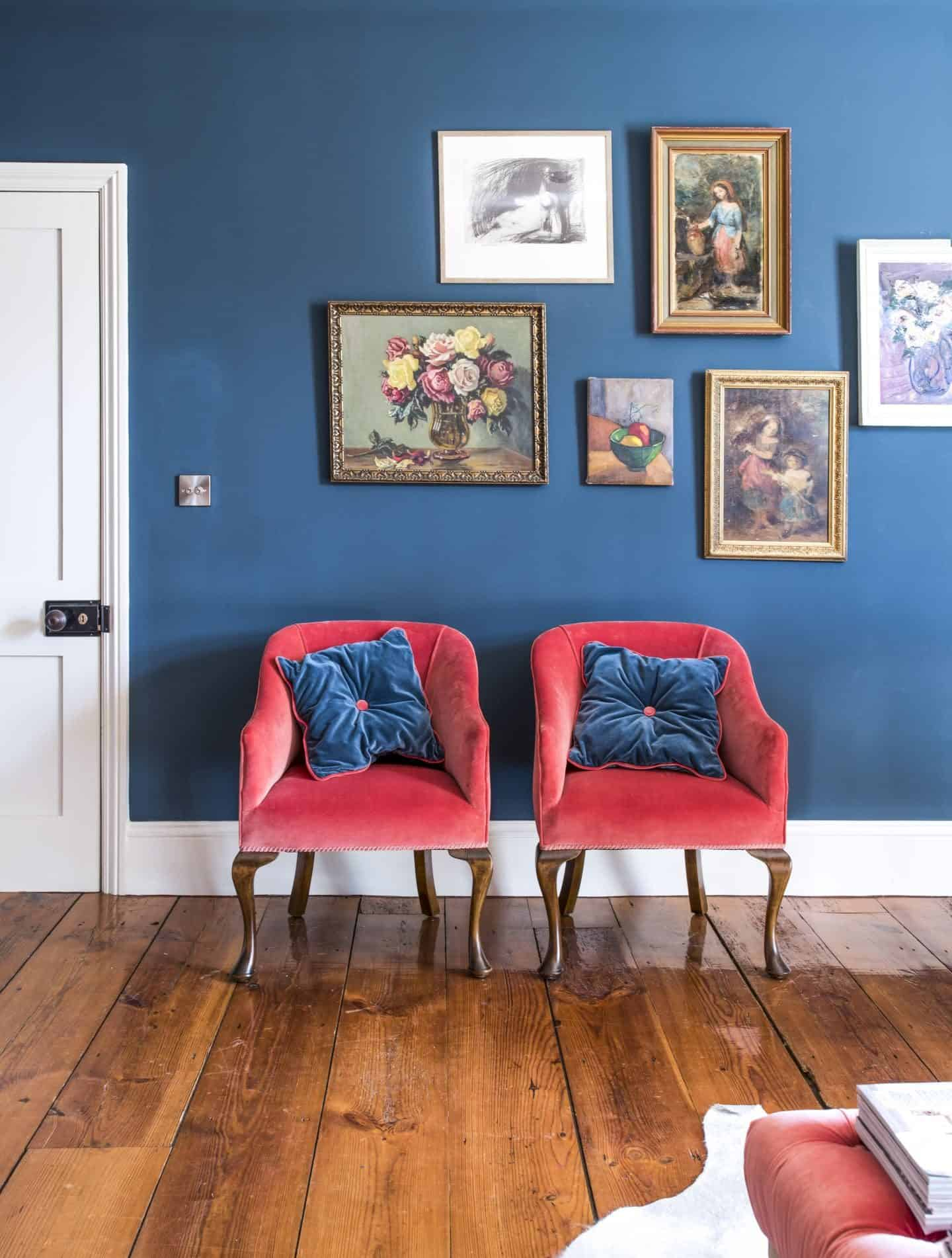 Image from the book Love Colour ©annastarmer - A blue wall with red chairs in front