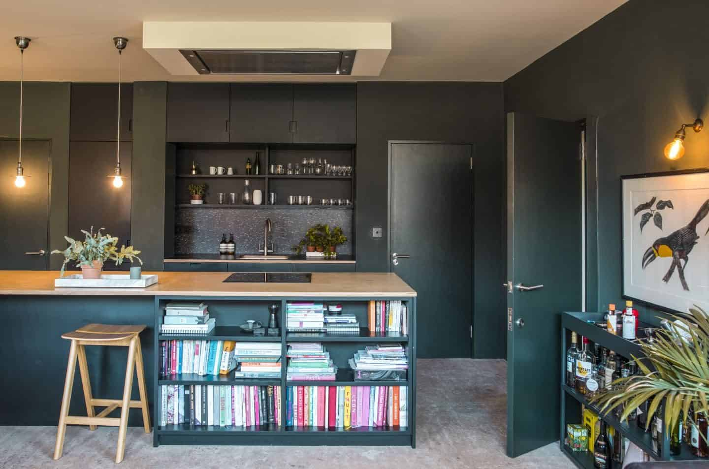 Image from the book Love Colour ©annastarmer - a dark grey kitchen with wood topped island.